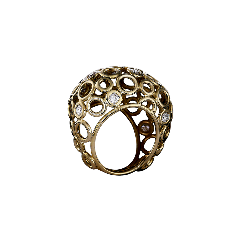 An openwork bombe ring sprinkled with diamonds in blackened 18 karat yellow gold by Solange Azagury-Partridge