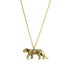 A leopard pendant in 18 karat yellow gold with blackened spots on a chain by Solange Azagury-Partridge