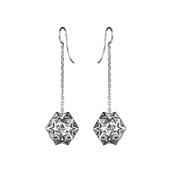 A pair of earrings with three dimensional star and triangular openwork balls suspended on chain in 18 karat white gold by Solange Azagury-Partridge