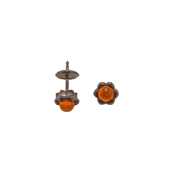 A pair of lotus motif stud earrings set with round cabochon fire opal in blackened 18 karat white gold by Solange Azagury-Partridge