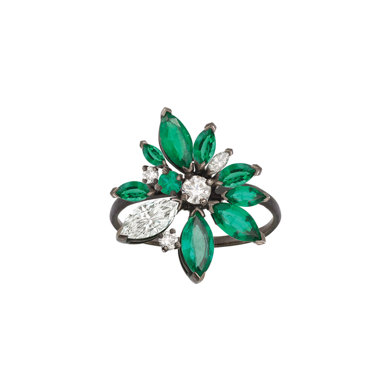 A lotus flower ring with marquise and round brilliant cut emeralds and diamonds in blackened 18 karat white gold by Solange Azagury-Partridge