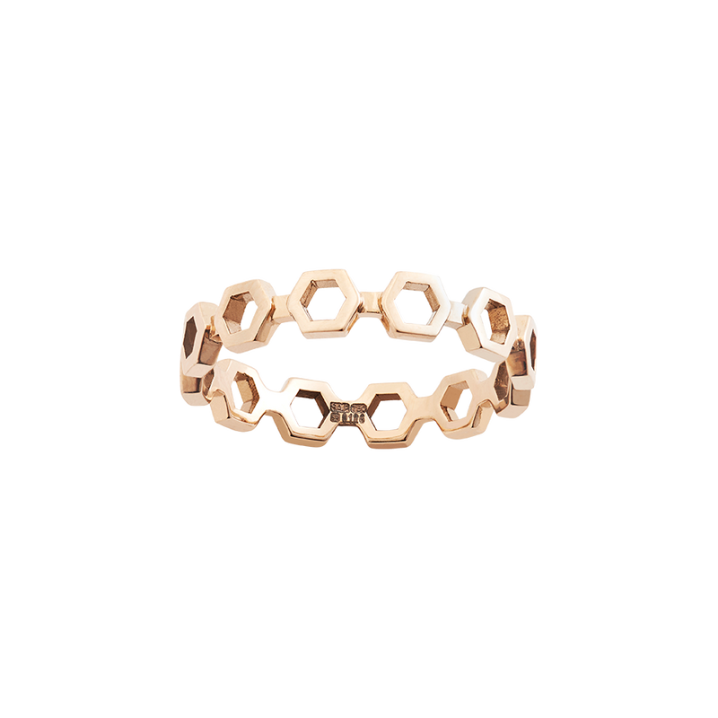 A hexagon motif band ring in 18 karat yellow gold by Solange Azagury-Partridge