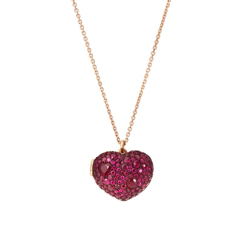 A locket that both celebrates a love for a partner and keeps it private all at once set with rubies, red ceramic plate with a sapphire glass hidden storage compartment on a chain set in 18 karat rose gold by Solange Azagury-Partridge