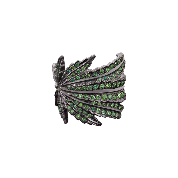 A marijuana leaf motif ring set with round brilliant cut green diamonds in blackened 18 karat white gold by Solange Azagury-Partridge
