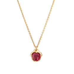 A pendant composed of a ruby gently held within a pair of 18k yellow gold hands by Solange Azagury-Partridge