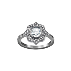 A ring with a rose cut diamond centre surrounded by brilliant cut diamonds and a diamond set shank in blackened 18 karat white gold by Solange Azagury-Partridge