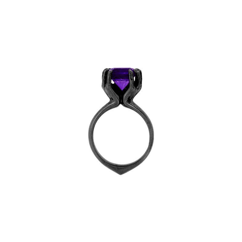 An amethyst held by two outstretched hands ring in blackened 18 karat white gold by Solange Azagury-Partridge