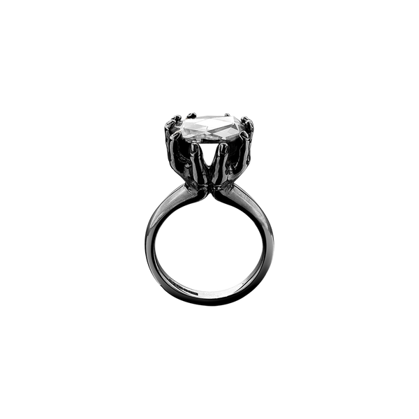 A rose cut diamond held by two outstretched hands ring in blackened 18 karat white gold by Solange Azagury-Partridge