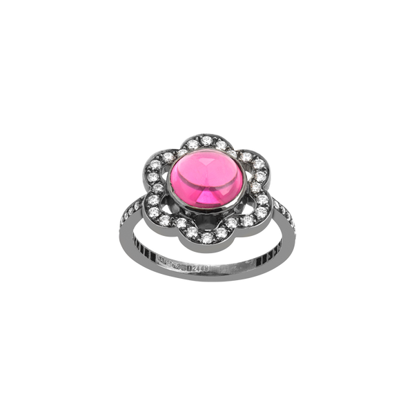 An orbital ring composed of a pink tourmaline with flower shaped diamond pavé surrounding with blackened 18 karat white gold by Solange Azagury-Partridge