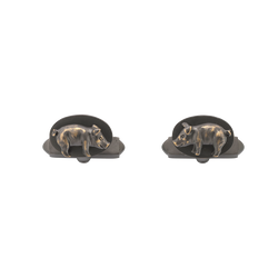 A pair of pig cufflinks in blackened 18 karat yellow gold by Solange Azagury-Partridge