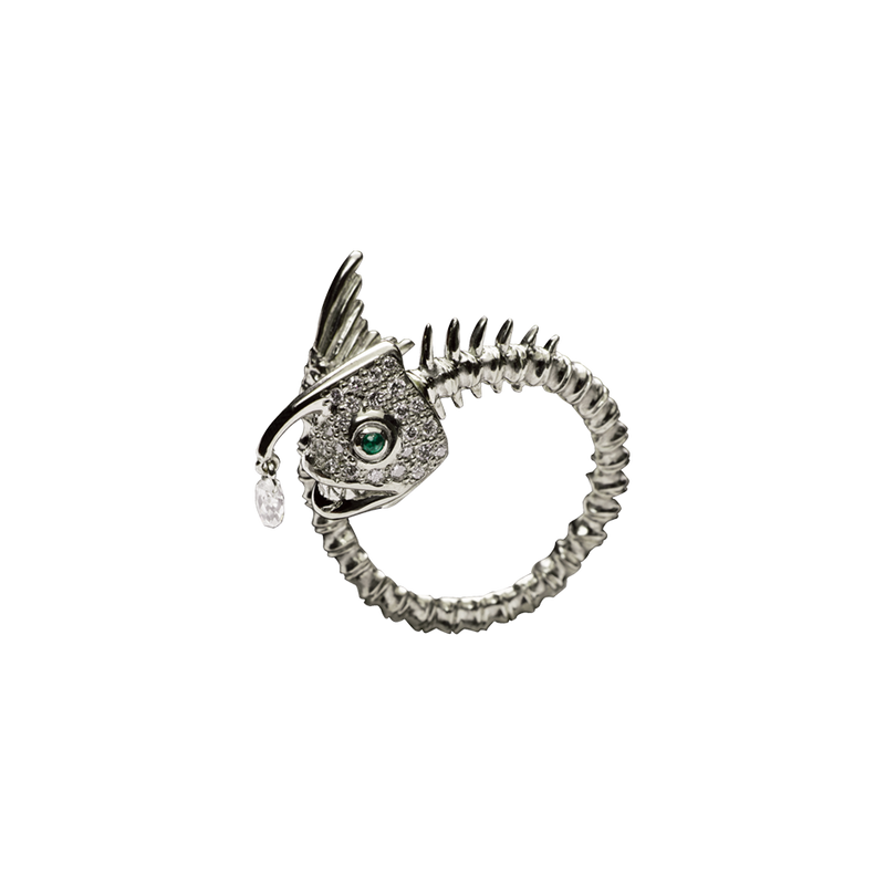 A zodiac skeleton pisces motif ring with diamonds, emerald eyes and a briolette diamond drops in 18 karat white gold by Solange Azagury-Partridge