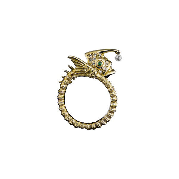 A zodiac skeleton pisces motif ring with diamonds, emerald eyes and a briolette diamond drops in 18 karat yellow gold by Solange Azagury-Partridge