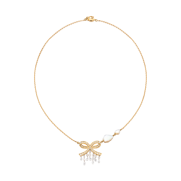 A necklace composed of a bow with diamonds, briolette diamonds drops and two mother of pearl cloud in 18 karat yellow gold  by Solange Azagury-Partridge