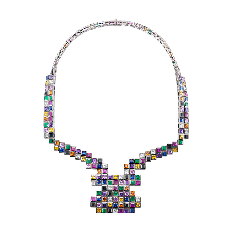 A necklace set in a random layout of square and princess cut diamonds, emeralds, amethysts, rubies, black spinel and yellow, blue, orange and pink sapphires in blackened 18 karat white gold by Solange Azagury-Partridge