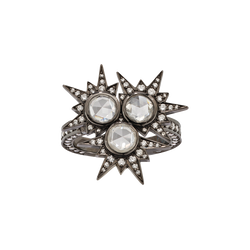 A  ring composed of rose and round brilliant cut diamonds in the centre with diamonds spikes surrounded set in blackened 18 karat white gold by Solange Azagury-Partridge