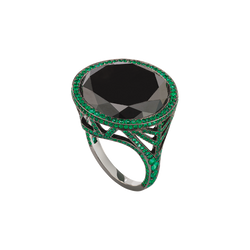 An open work ring with a black diamond on the top and emeralds pavé in blackened 18 karat white by Solange Azagury-Partridge