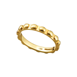 A raised round motif patterned band ring in 18 karat yellow gold by Solange Azagury-Partridge