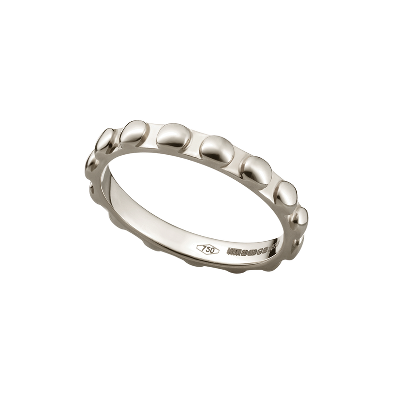 A raised round motif patterned band ring in 18 karat white gold by Solange Azagury-Partridge