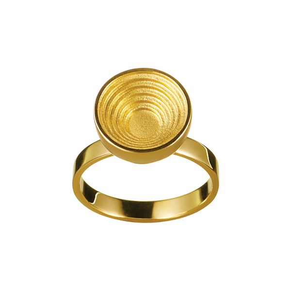 A engraved spinning round in 18 karat yellow gold by Solange Azagury-Partridge