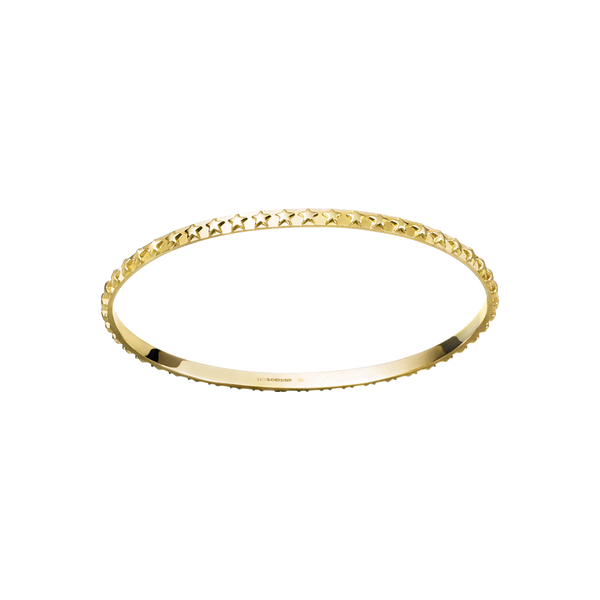 A  raised star motif patterned bangle in 18 karat yellow gold by Solange Azagury-Partridge