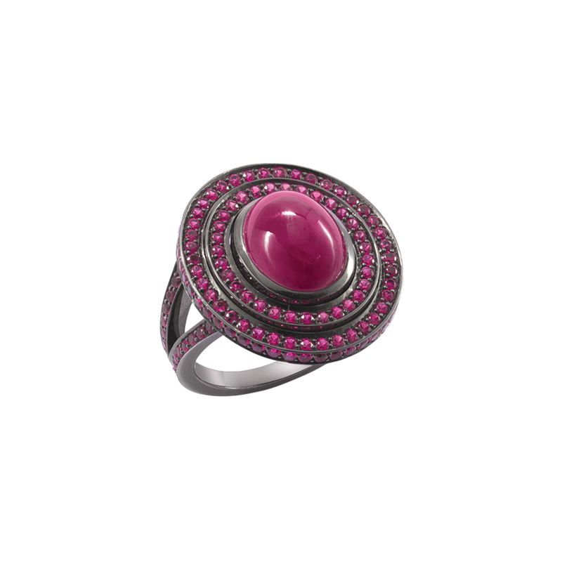 A ring with an oval cabochon ruby centre stone surrounded by ruby set tiers and ruby set shark in blackened 18 karat white gold by Solange Azagury-Partridge