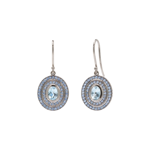 A pair step earrings with oval aquamarine centre stones surrounded by two tiers of sapphires in blackened 18 karat white gold by Solange Azagury-Partridge