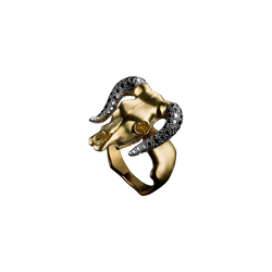 A skeleton face taurus motif ring set with brilliant cut diamonds in blackened on the horns in 18 karat yellow gold by Solange Azagury-Partridge