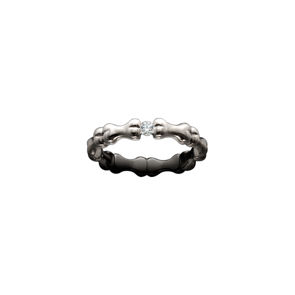 A bones motif ring set with a brilliant cut diamond in 18 karat white gold by Solange Azagury-Partridge