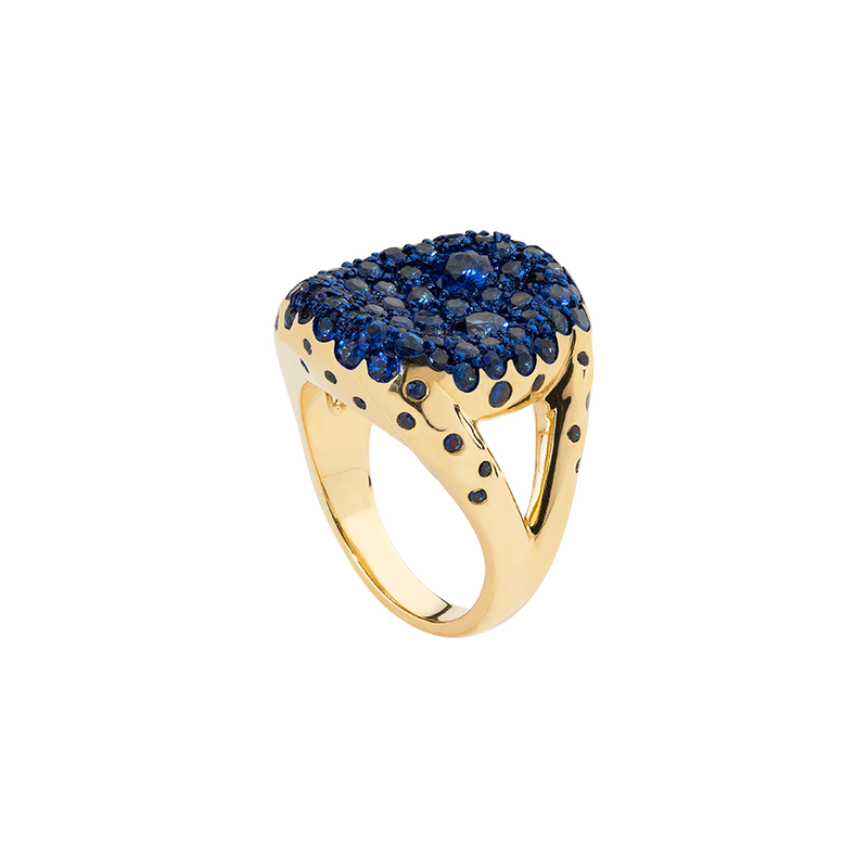An 18 karat yellow gold ring with sapphires pavé on a concave top and blue ceramic plate by Solange Azagury-Partridge
