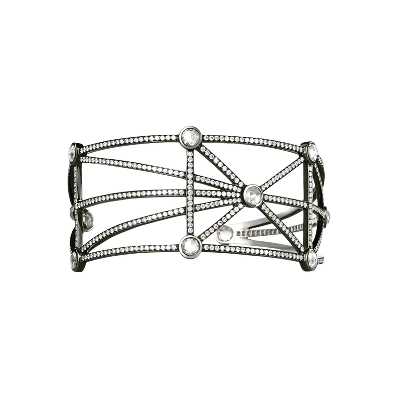 An open work bangle set with brilliant and rose cut diamonds in blackened 18 karat white gold by Solange Azagury-Partridge