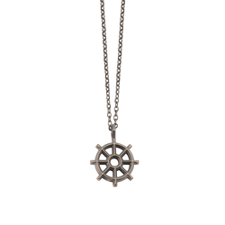 A dharma chakra pendant in blackened 18 karat yellow gold by Solange Azagury-Partridge