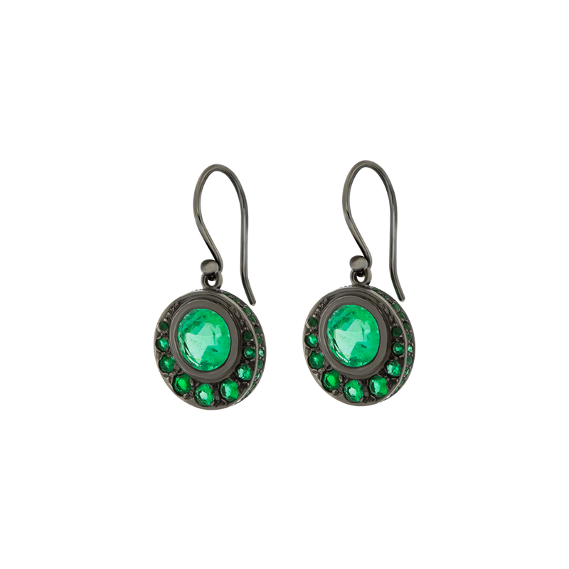 A pair of crescent shaped drop earrings made from emeralds set in 18 karat blackened white gold by Solange Azagury-Partridge