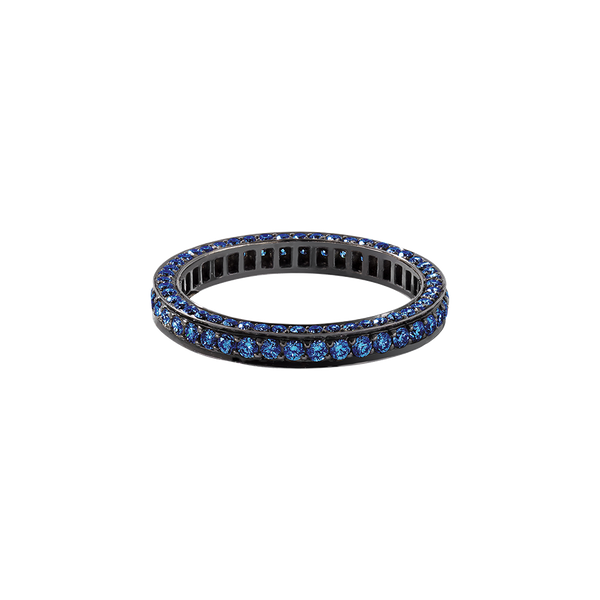 A eternity ring set on three sides with brilliant cut blue sapphires in blackened 18 karat white gold by Solange Azagury-Partridge