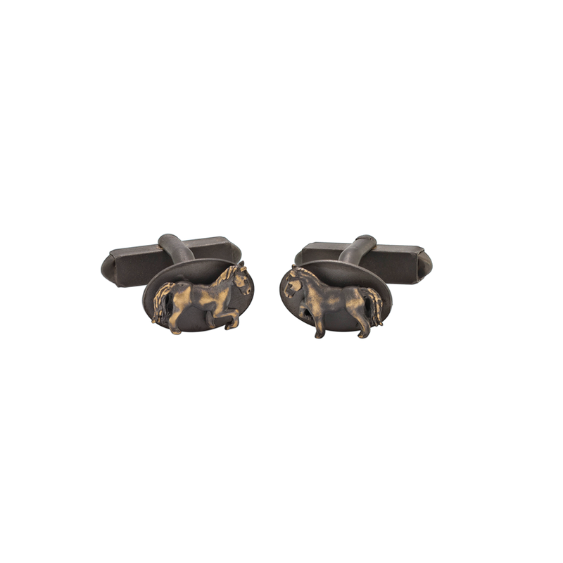A horse motif cufflinks in blackened 18 karat yellow gold by Solange Azagury-Partridge