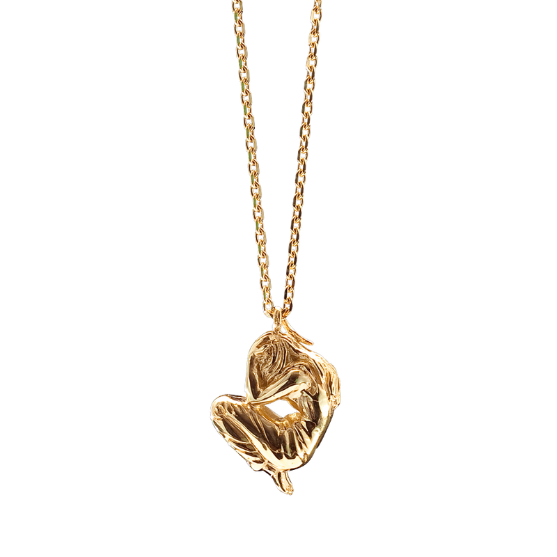 A crouching woman motif pendant in 18 karat yellow gold by Solange Azagury-Partridge
