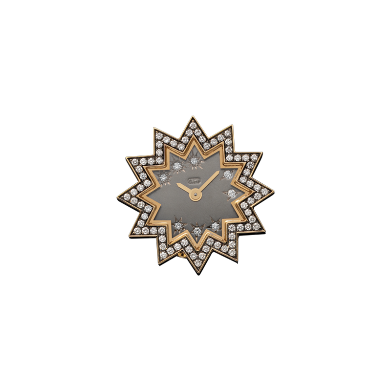 A star shaped analogue watch ring with diamonds for the numbers and diamonds pavé  surrounding in 18 karat yellow gold by Solange Azagury-Partridge