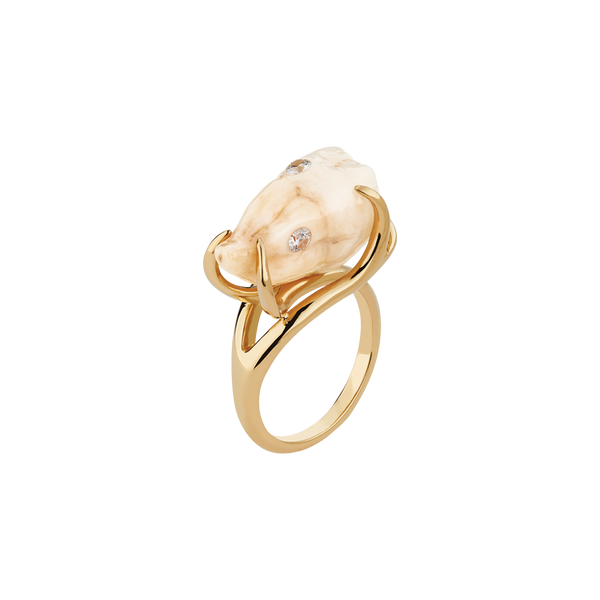 A ceramic wisdom tooth with two diamonds fillings set in 18 karat yellow gold by Solange Azagury-Partridge