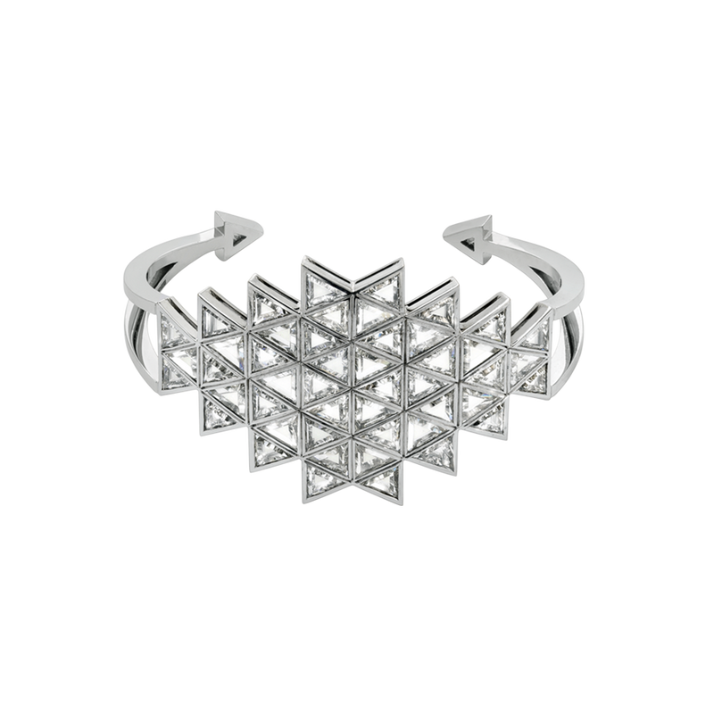 An open work bangle composed of horizontal rhombus shaped with triangle diamonds set in 18 karat white gold by Solange Azagury-Partridge