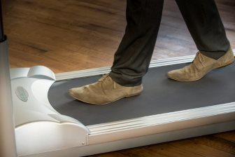 feet on treadmill desk