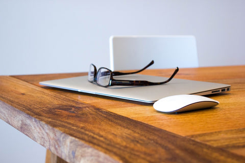 glasses and computer on desk