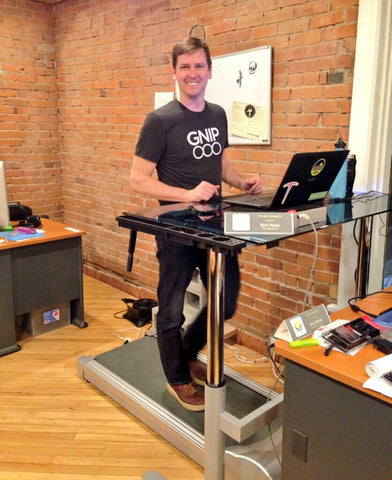 man on treadmill desk