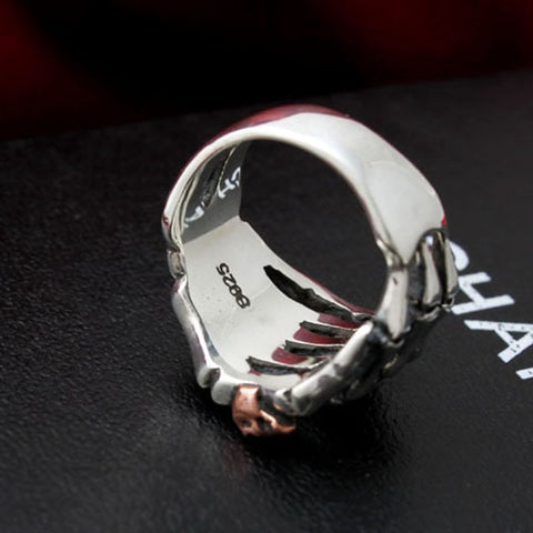 Image of 925 Sterling Silver Skull Hand With Skull Head Ring
