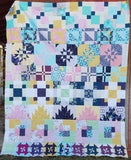 The Disappearing Row Along is a free quilt along! You'll sew up disappearing quilt blocks all year long! 64x80 row quilt Explore this fun technique.