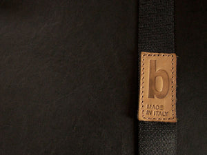 signature hot stamped detail on leather. handmade in Italy