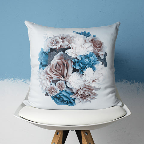 blue floral pillow on chair