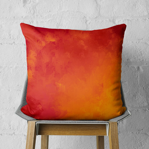 red and orange throw pillow on chair