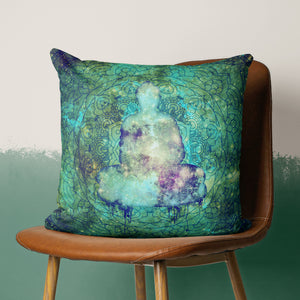 space Buddha pillow on chair