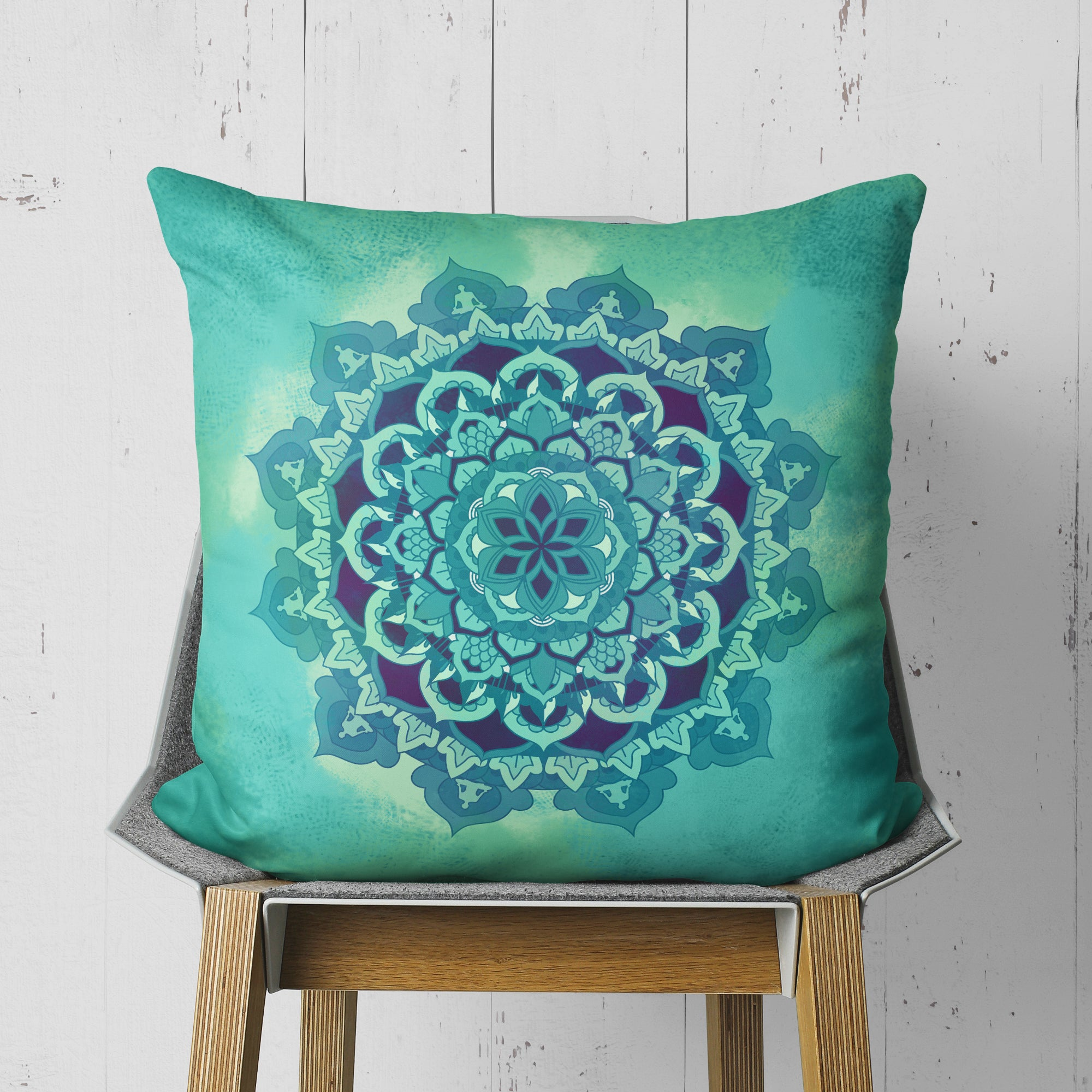 Green mandala throw pillow on chair