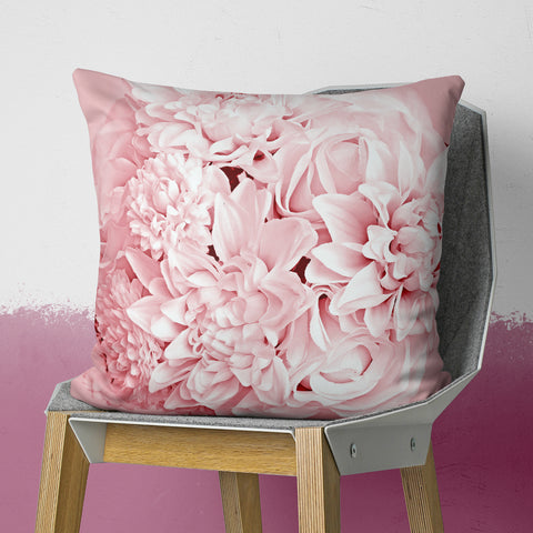 pink floral pillow on chair