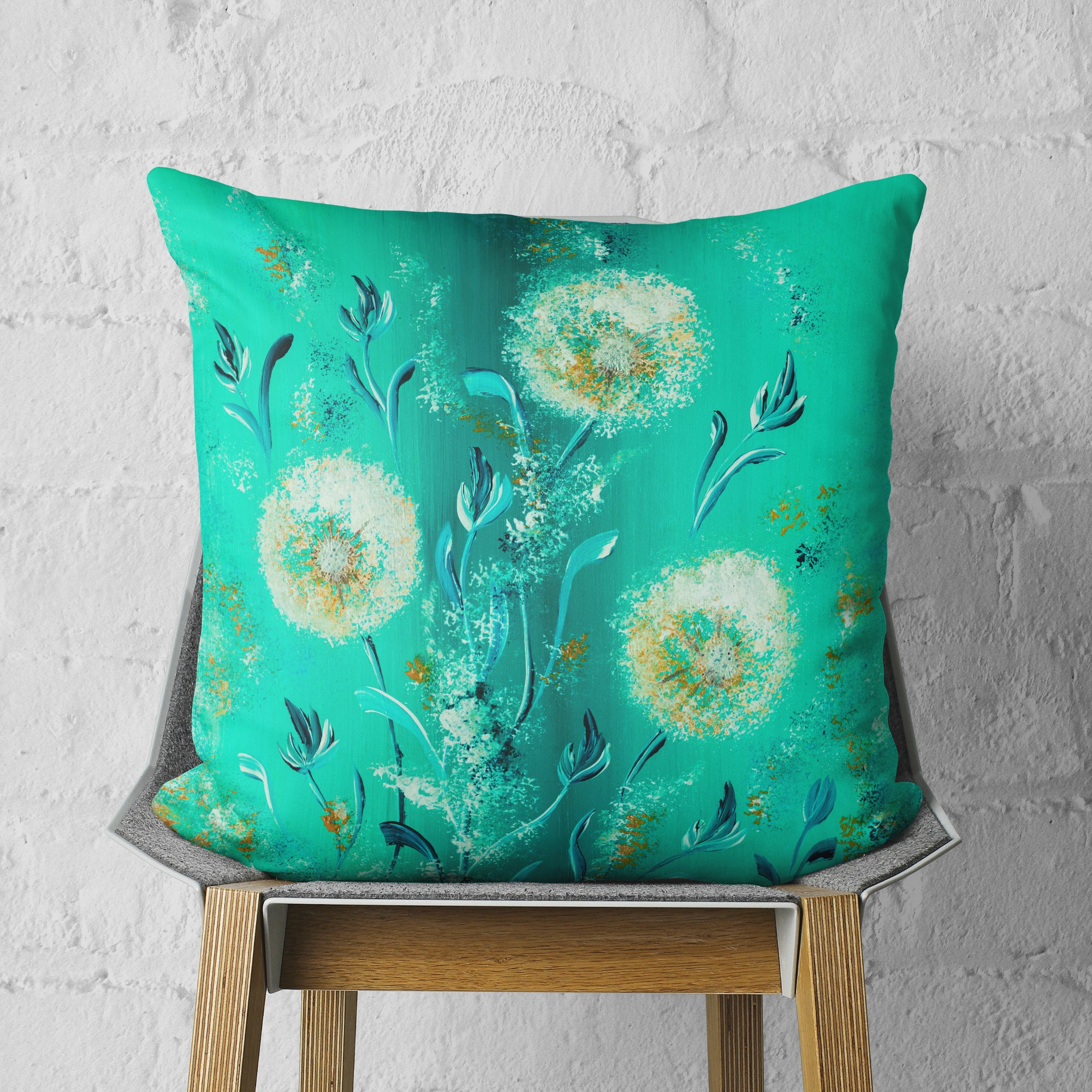 Turquoise throw pillow on chair
